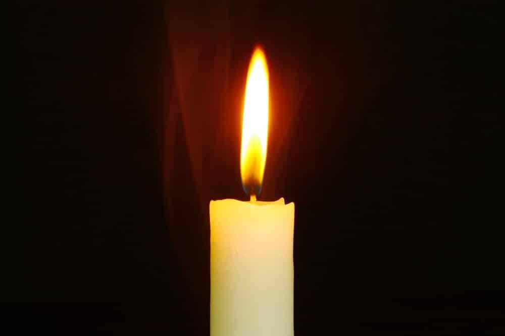 Why do candles burn black?